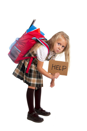 sweet little blonde schoolgirl asking for help carrying heavy backpack or school bag full causing stress and pain on back