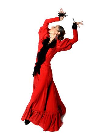 bailando flamenco: joven española bailando sevillanas con castañuelas en las manos que llevan vestido rojo popular