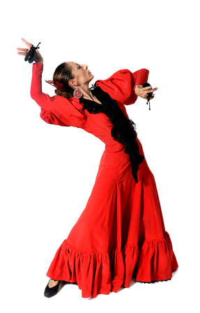 young Spanish woman dancing Sevillanas with castanets in hands wearing folk red dress  Stock Photo