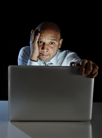 lascivious: young addict man alone at night sitting watch computer laptop
