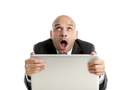 internet porn: excited desperate businessman watching porn in internet isolated on white background