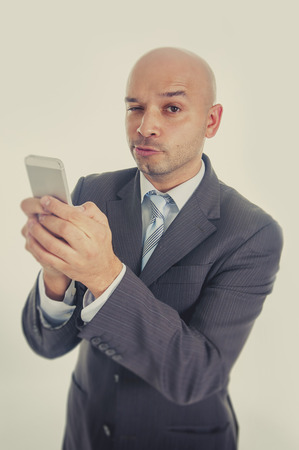 cell phone addiction: happy young friendly businessman using compulsively cell phone in  social network