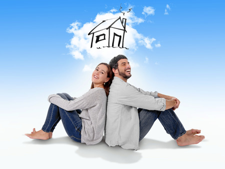 Young attractive and modern couple in love smiling happy together sitting on floor thinking and imaging their new house, home, flat or apartment in real state concept Archivio Fotografico