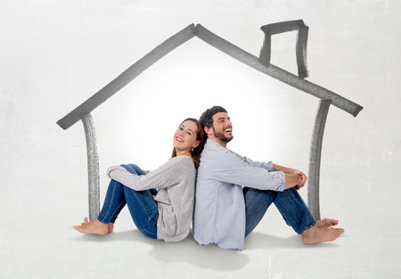 mortgage: Young attractive and modern couple in love smiling happy together sitting on floor thinking and imaging their new house, home, flat or apartment in real state concept Stock Photo