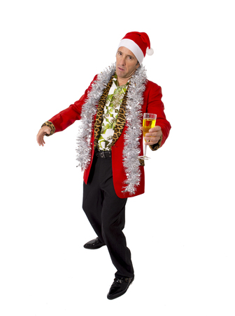 wasted drunk rake senior businessman in Champagne Christmas toast celebrating xmas party at work wearing Santa hat and red jacket isolated on white background photo