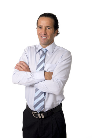 attractive confident and successful senior Hispanic businessman at work posing alone standing with smile on his face looking happy and relaxed isolated on white background photo