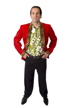 funny rake playboy and bon vivant mature man wearing red casino jacket and Hawaiian shirt standing happy and confident posing attractive gigolo alike isolated on white photo