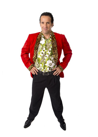 funny rake playboy and bon vivant mature man wearing red casino jacket and Hawaiian shirt standing happy and confident posing attractive gigolo alike isolated on white