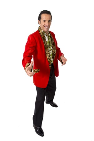 gigolo: funny rake playboy and bon vivant mature man wearing red casino jacket and Hawaiian shirt standing happy and confident posing attractive gigolo alike isolated on white