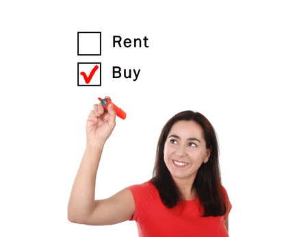 buying questions: Latin woman choosing buy to rent option ticking buying box with red marker on glass isolated on white background in housing, real estate and property owner concept