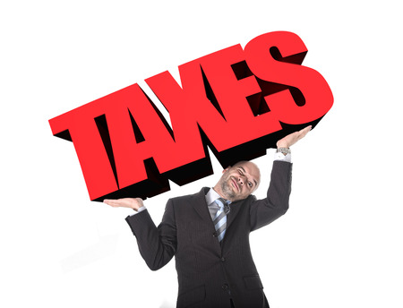 financial burden: businessman in stress carrying heavy taxes 3d text word on his arms as a painful burden isolated on white background in tax paying and financial problem concept