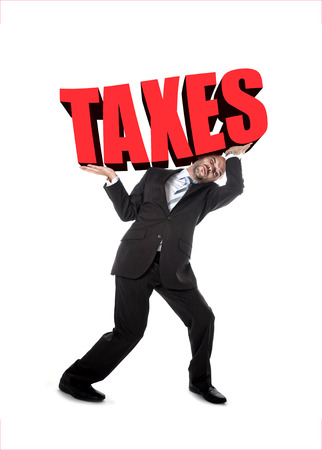 financial burden: businessman in stress carrying heavy taxes 3d text word on his shoulders as a painful burden isolated on white background in tax paying and financial problem concept Stock Photo