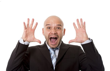 screaming head: desperate Brazilian bald businessman screaming and shouting crazy stress with mouth open and mad face expression in overwork and business crisis concept