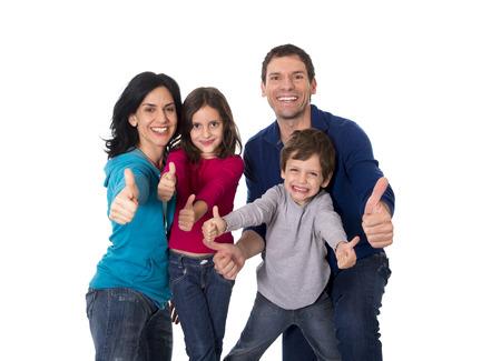 mujeres latinas: joven madre feliz familia brasile�a y padre jugando con el peque�o hijo e hija se divierten juntos aisladas sobre fondo blanco Foto de archivo