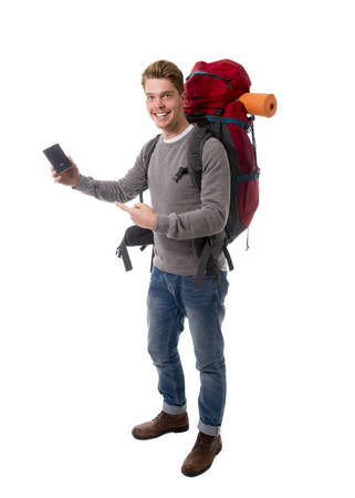 young attractive  backpacker tourist holding passport carrying backpack ready for travel and adventure on vacations and holidays isolated on white background photo