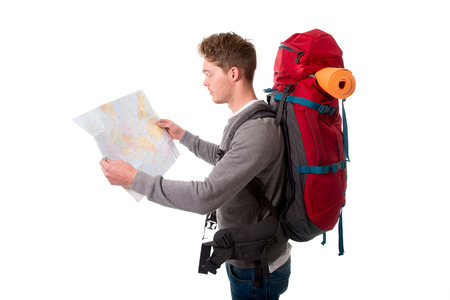 all right: young attractive backpacker tourist looking map carrying big backpack ready for travel and adventure on vacations and holidays isolated on white background
