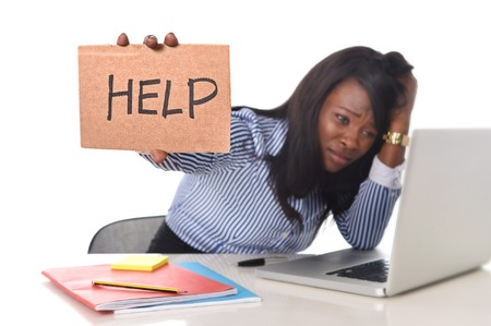 ethnicity: black African American ethnicity tired and frustrated woman working as secretary in stress at work office desk with computer laptop asking for help in business frustration concept