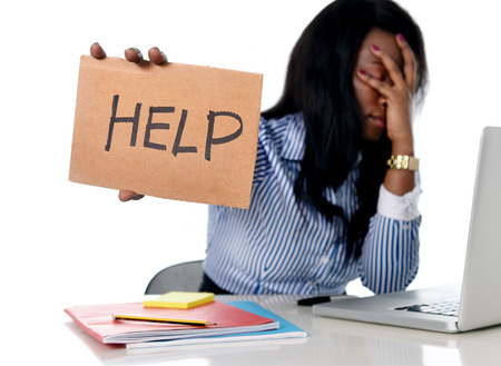 receptionist: black African American ethnicity tired and frustrated woman working as secretary in stress at work office desk with computer laptop asking for help in business frustration concept