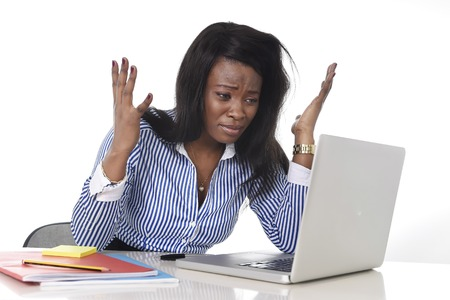 black African American ethnicity tired and frustrated woman working as secretary in stress at work office desk with computer laptop desperate in business frustration concept