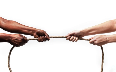 multi race: black ethnicity arms with hands pulling rope against white Caucasian race person in stop racism and xenophobia concept, immigration and multiracial  respect