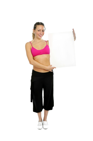 pink bra: young sexy attractive woman in sport pants and pink bra holding blank billboard card with copy space in join the gym and fitness club concept isolated on white background