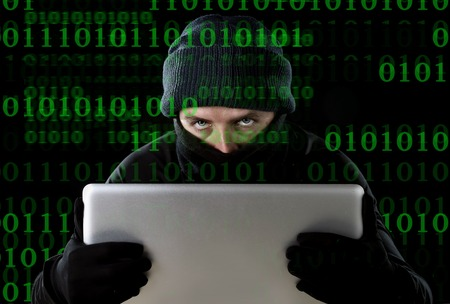 private access: hacker man in black using computer laptop for criminal activity hacking password and private information cracking password too access bank account data in cyber crime concept Stock Photo