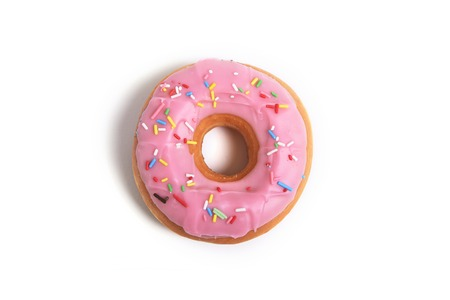 delicious and tempting pink donut with toppings isolated on white background in unhealthy nutrition and sugar and sweet cake addiction concept Stock Photo