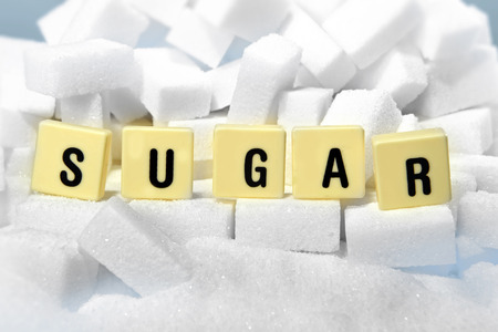 addiction: sugar block letters word on pile of sugar cubes close up in addiction , sweet nutrition , unhealthy eating and diet concept