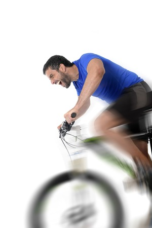 harsh: young sport man riding mountain bike training hard on sprint in fitness and competition concept with excited face expression isolated on white background with harsh motion blur