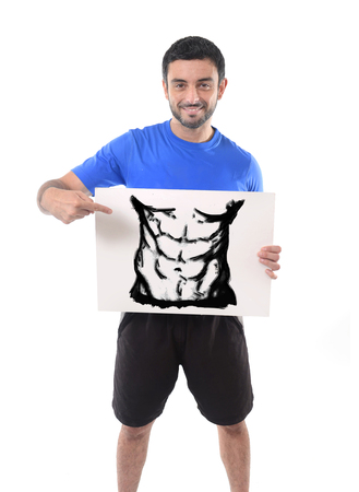 six pack: young happy attractive man holding billboard with six pack abdomen cartoon draw for advertising and marketing of gym or fitness sport club in healthy lifestyle concept isolated on white background Stock Photo