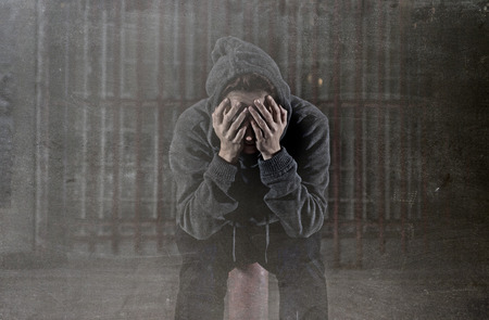 victim: sad woman alone wearing hoodie on street suffering depression looking  desperate and helpless sitting lonely in urban night background in female victim of abuse concept grunge dirty edit