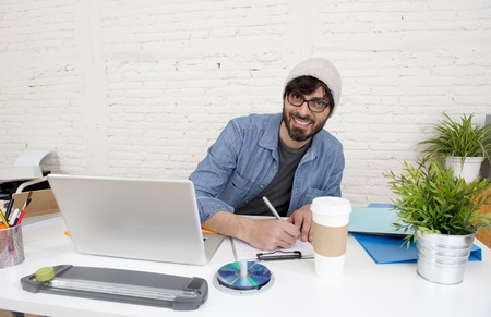 30s: corporate portrait of young hispanic attractive hipster businessman on his 30s working at modern home office with computer laptop in creative freelancer and self employed business model