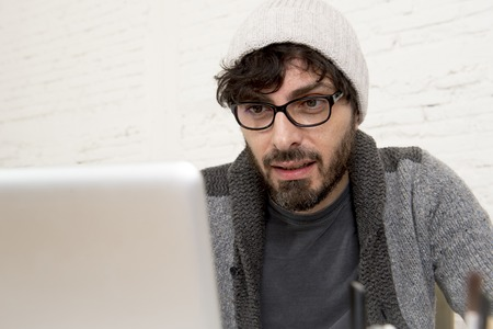 30s: young hispanic attractive  hipster 30s businessman working at modern home office with computer laptop dressing casual in creative freelancer business success concept