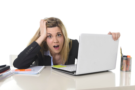 mess: young beautiful business woman suffering stress working at office computer desk feeling tired and desperate looking overworked overwhelmed and frustrated in mess and chaos