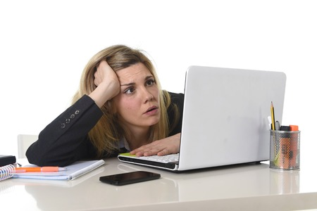 young beautiful business woman suffering stress working at office computer desk feeling tired and desperate looking overworked overwhelmed and frustrated in mess chaos situation