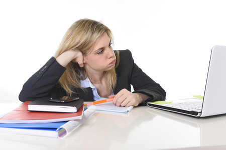 young beautiful business woman suffering stress working at office computer desk feeling tired and desperate looking overworked overwhelmed and frustrated