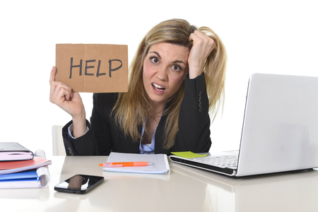 young beautiful business woman suffering stress working at office computer desk asking for help feeling tired and desperate looking overworked overwhelmed and frustrated