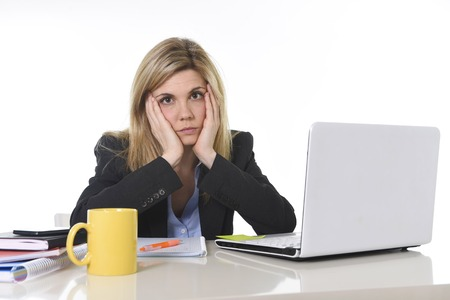 overwhelmed: young beautiful business woman suffering stress working at office computer desk feeling tired and desperate looking overworked overwhelmed and frustrated