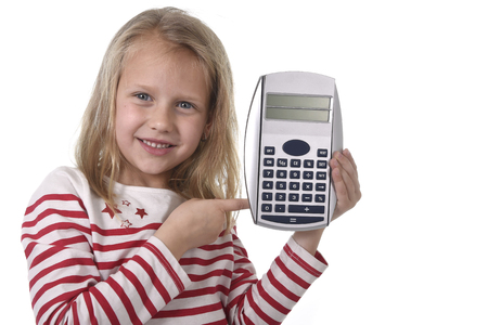 junior education: sweet beautiful female child 6 to 8 years old with cute blonde hair and blue eyes holding calculator isolated on white in education and primary or junior school supplies concept