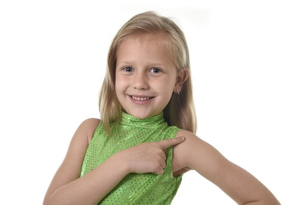 6 or 7 years old little girl with blond hair and blue eyes smiling happy posing isolated on white background pointing shoulder in language lesson for child education and body parts school chart serie Stockfoto