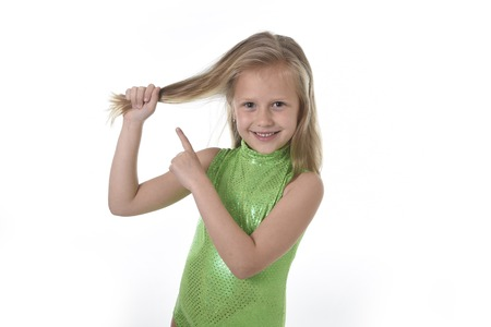 6 7 years: 6 or 7 years old little girl with blue eyes smiling happy posing isolated on white background pulling pointing her blond hair in language lesson for child education and body parts school chart serie
