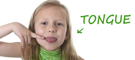 blue face: 6 or 7 years old little girl with blond hair and blue eyes smiling happy posing isolated on white background pointing tongue in learning English language school education body parts card set