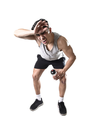 sweaty: young attractive sport man with athletic fit body  in exhausted and tired face expression breathing after hard training workout wet and sweaty isolated on white background in fitness healthy lifestyle
