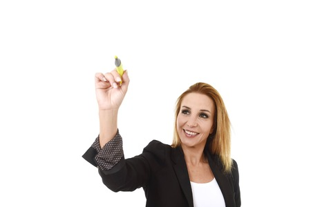 glassboard: business portrait of attractive blond successful businesswoman holding marker writing or pointing to transparent glassboard screen isolated in white smiling happy and confident with copy space