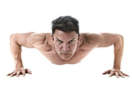 40 45: 40 to 45 years old attractive fit man doing push up workout training hard  fitness routine with strong and muscular body isolated on white background in health sport and bodybuilding concept