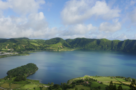 crater lake: amazing beautiful scenic landscape view of Blue Lake or Lagoa Azul in Sete Cidades of Sao Miguel island of Azores in Portugal in holiday tourism and vacation travel destinations concept