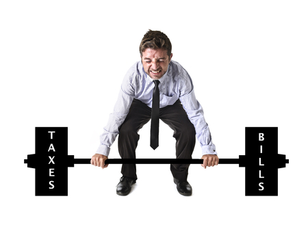 obligations: corporate composite of young attractive businessman power lifting heavy weights metaphor to cost of living , obligations , taxes and bills in burden and struggle concept isolated on white background Stock Photo