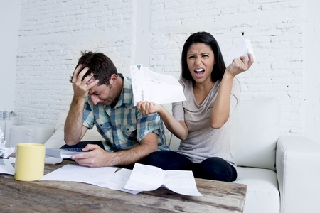 Superb Young Sad Couple At Home Living Room Couch Calculating Monthly Expenses  Worried In Stress With Bank