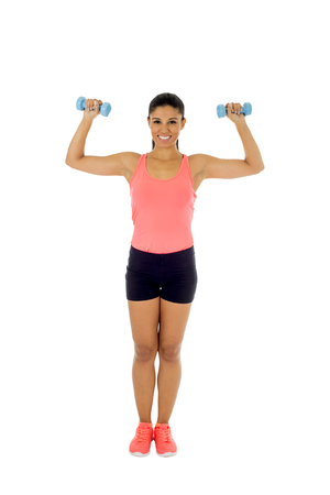 dumb bells: young attractive happy latin woman in sport clothes with beautiful smile holding weight dumbbell doing fitness workout isolated on white background in healthy lifestyle concept