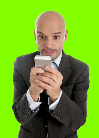 mania: happy young friendly businessman using compulsively cell phone in  social network , mobile and internet addiction concept isolated on green chroma key screen background